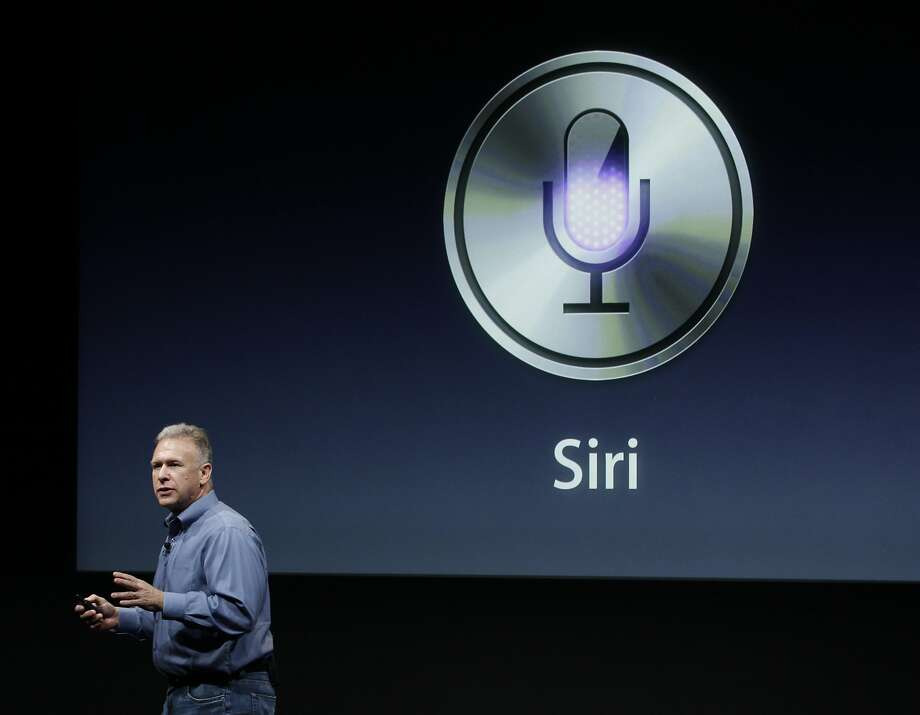 """FILE - In this Oct. 4, 2011, file photo, Apple's Phil Schiller talks about Siri during an announcement at Apple headquarters in Cupertino, Calif. Apple's Siri made a big splash when the wisecracking digital assistant debuted in 2011. But as its competitors jockey to build intelligent """"chat bots"""" and voice-controlled home systems capable of more challenging artificial-intelligence feats, Siri at times no longer seems cutting edge. On Monday, June 13, 2016, Apple is expected to demonstrate how much smarter Siri can get as it kicks off its annual software conference. It's a potentially momentous time for the company; sales of its flagship iPhone are slowing, and AI is emerging as a key tech battleground.  (AP Photo/Paul Sakuma, File) Photo: Paul Sakuma, Associated Press"""