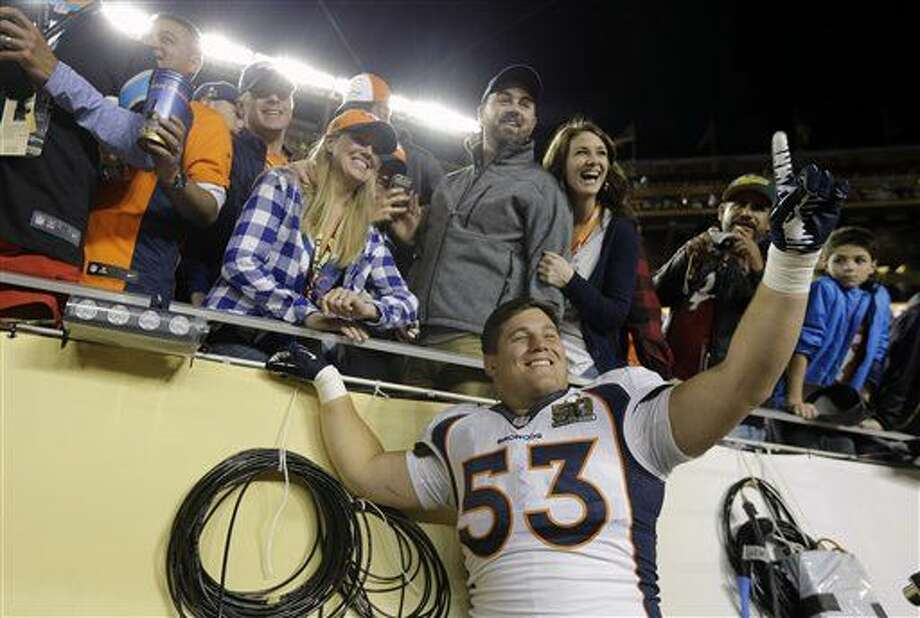 Denver Broncos' James Ferentz (53) celebrates with people in the stands after the NFL Super Bowl 50 football game Sunday, Feb. 7, 2016, in Santa Clara, Calif. The Broncos won 24-10. (AP Photo/Julie Jacobson)