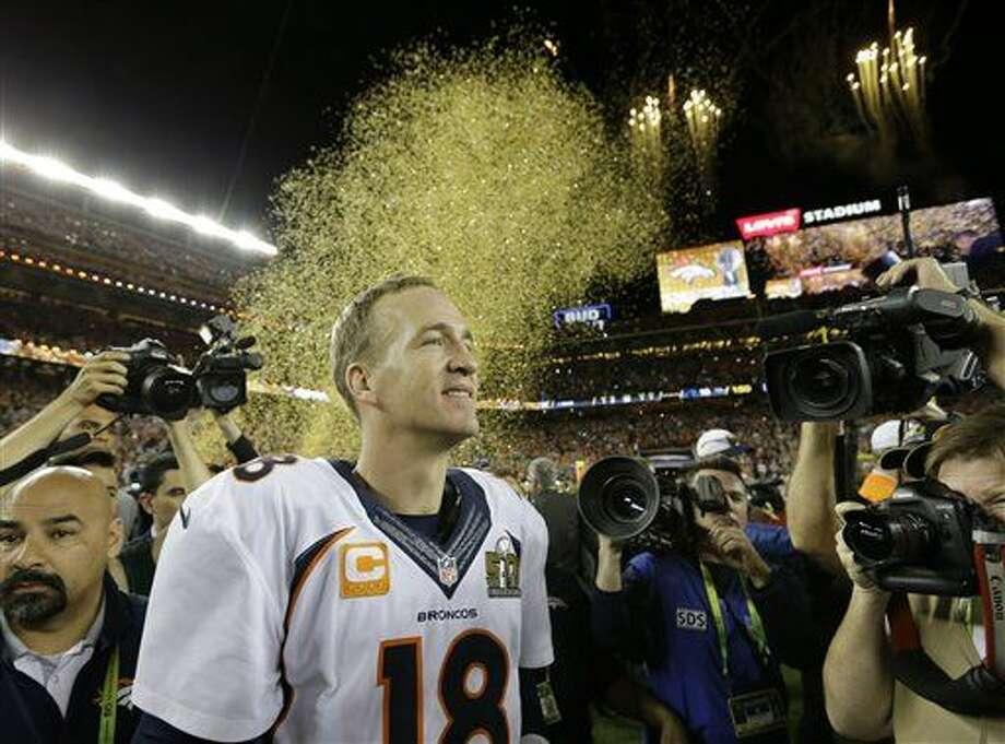 Denver Broncos' Peyton Manning (18) celebrates after the NFL Super Bowl 50 football game Carolina Panthers Sunday, Feb. 7, 2016, in Santa Clara, Calif. The Broncos won 24-10. (AP Photo/David J. Phillip)