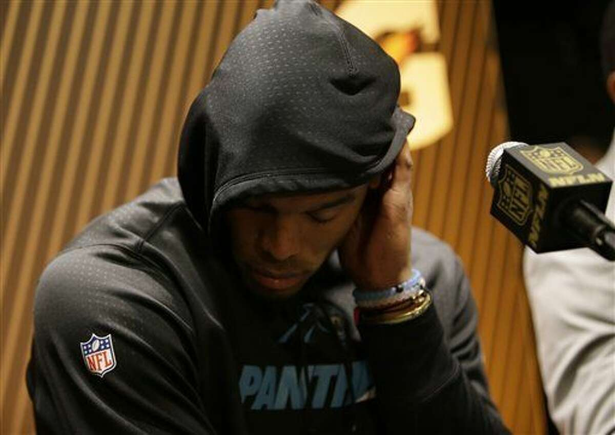 Carolina Panthers' Cam Newton answers questions after the NFL Super Bowl 50 football game against the Denver Broncos Sunday, Feb. 7, 2016, in Santa Clara, Calif. The Broncos won 24-10. (AP Photo/Marcio Jose Sanchez)