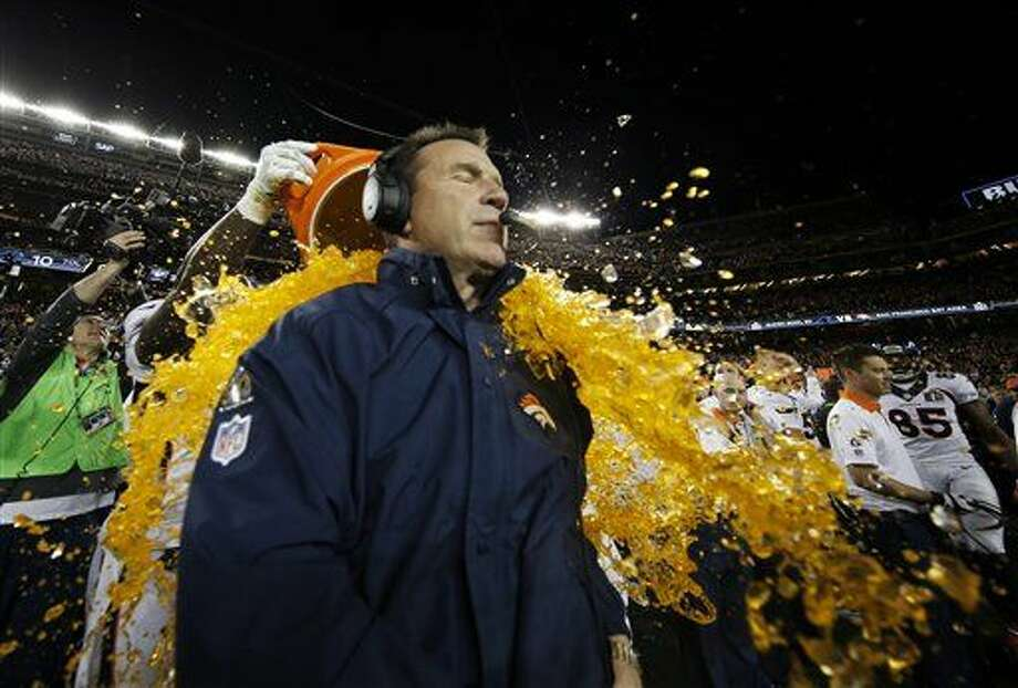 Denver Broncos' head coach Gary Kubiak gets soaked after their win against the Carolina Panthers in the NFL Super Bowl 50 football game Sunday, Feb. 7, 2016, in Santa Clara, Calif. The Broncos won 24-10. (AP Photo/Matt Slocum)