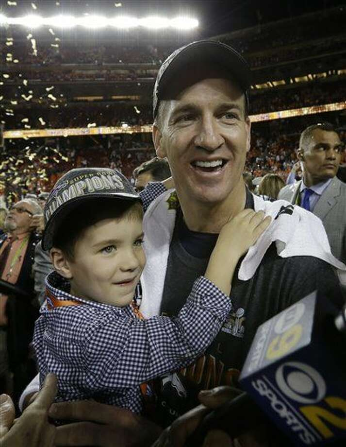 Denver Broncos' Peyton Manning (18) celebrates with his son, Marshall, after the NFL Super Bowl 50 football game Sunday, Feb. 7, 2016, in Santa Clara, Calif. The Broncos won 24-10. (AP Photo/David J. Phillip)