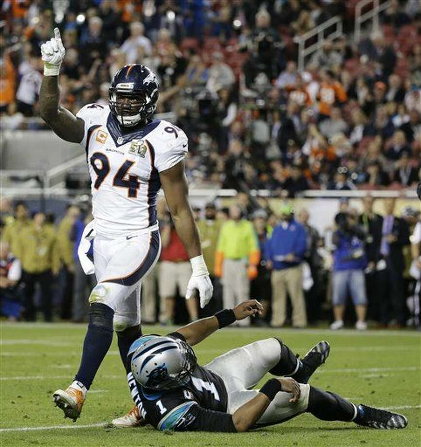 Carolina Panthers' Cam Newton (1) is sacked by Denver Broncos' DeMarcus Ware (94) during the second half of the NFL Super Bowl 50 football game Sunday, Feb. 7, 2016, in Santa Clara, Calif. (AP Photo/Jae C. Hong)