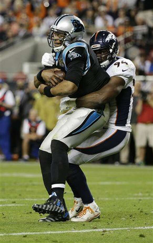 Carolina Panthers' Cam Newton, left, is sacked by Denver Broncos' DeMarcus Ware (94) during the second half of the NFL Super Bowl 50 football game Sunday, Feb. 7, 2016, in Santa Clara, Calif. (AP Photo/Jae C. Hong)