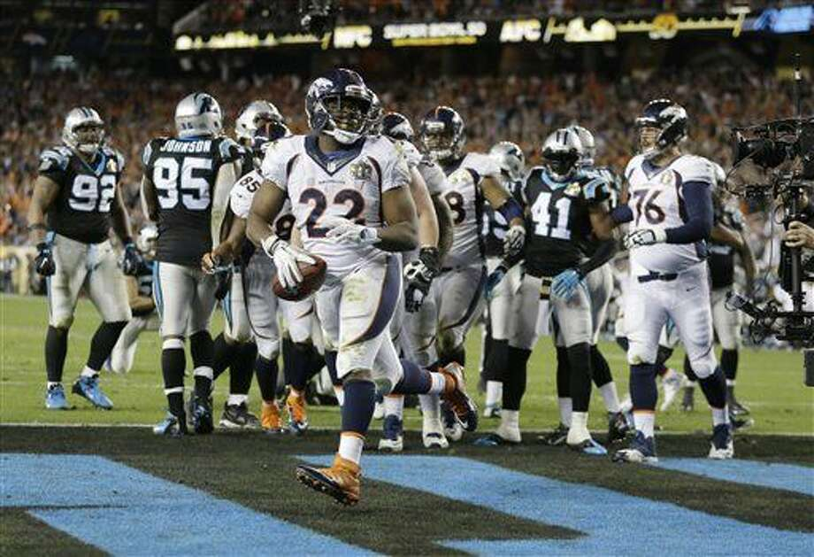 Denver Broncos' C.J. Anderson (22) celebrates his touchdown against the Carolina Panthers during the second half of the NFL Super Bowl 50 football game Sunday, Feb. 7, 2016, in Santa Clara, Calif. (AP Photo/Ben Margot)