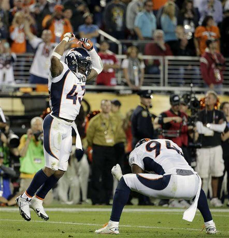 Denver Broncos' T.J. Ward (43) and DeMarcus Ware (94) celebrate during the second half of the NFL Super Bowl 50 football game Sunday, Feb. 7, 2016, in Santa Clara, Calif. (AP Photo/Matt York)