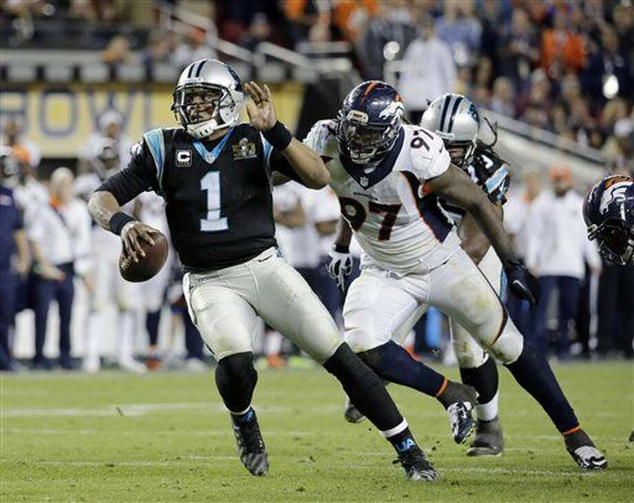 Denver Broncos' Malik Jackson (97) chases Carolina Panthers' Cam Newton (1) during the second half of the NFL Super Bowl 50 football game Sunday, Feb. 7, 2016, in Santa Clara, Calif. The Broncos defeated the Panthers 24-10. (AP Photo/Matt York)