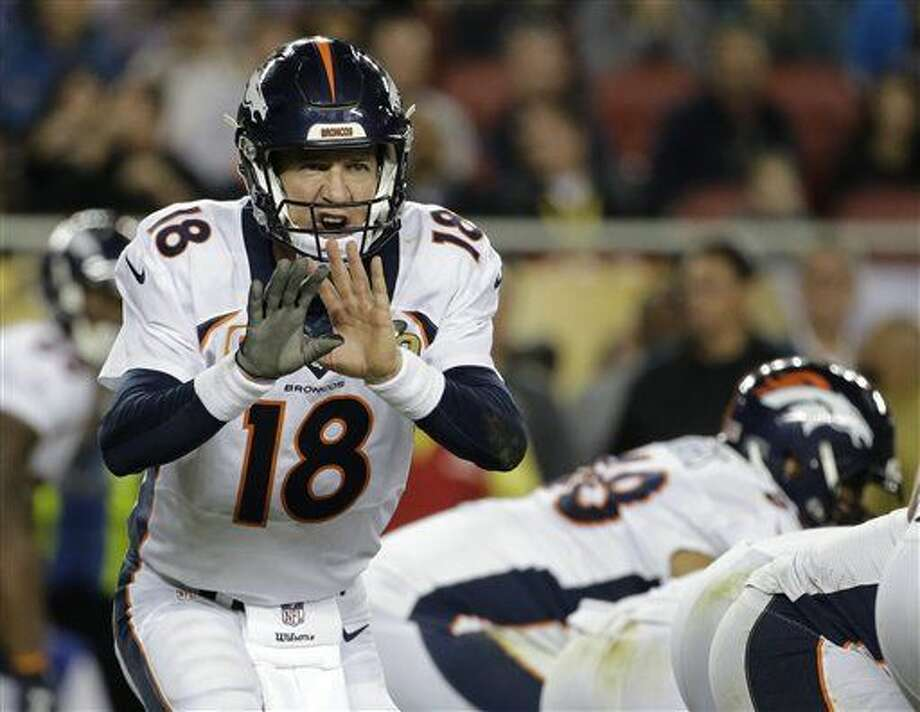 Denver Broncos' Peyton Manning (18) calls a play against the Carolina Panthers during the second half of the NFL Super Bowl 50 football game Sunday, Feb. 7, 2016, in Santa Clara, Calif. (AP Photo/Julio Cortez)
