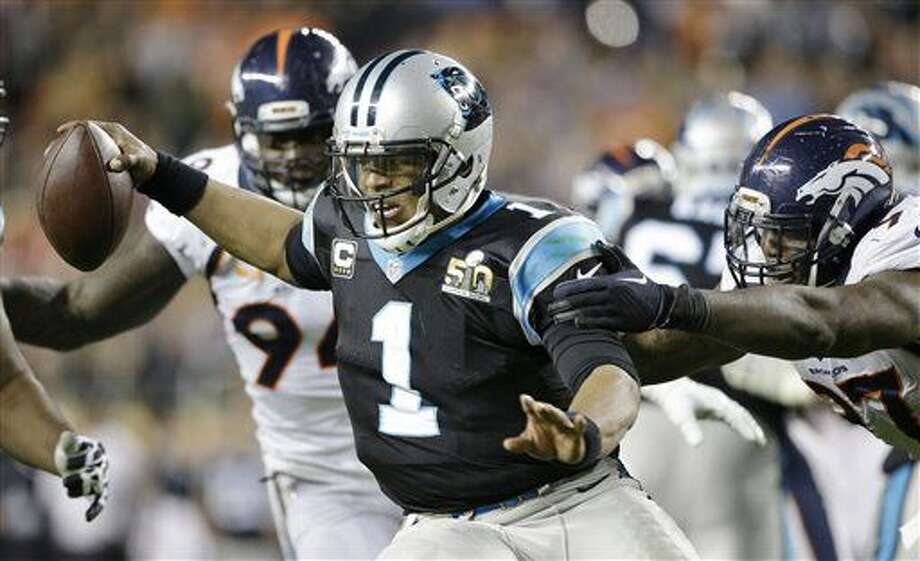 Carolina Panthers' Cam Newton (1) scrambles away from Denver Broncos' DeMarcus Ware (94) and Malik Jackson (97) during the second half of the NFL Super Bowl 50 football game Sunday, Feb. 7, 2016, in Santa Clara, Calif. (AP Photo/Ben Margot)
