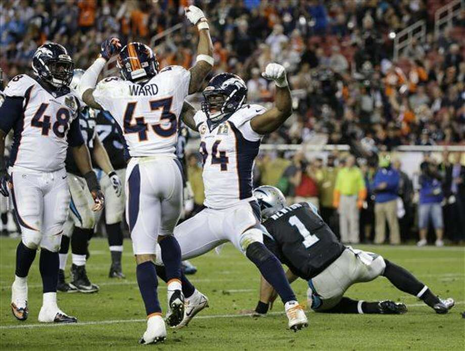Denver Broncos' DeMarcus Ware (94) celebrates after sacking Carolina Panthers' Cam Newton (1) with Shaquil Barrett (48) and T.J. Ward (43) during the second half of the NFL Super Bowl 50 football game Sunday, Feb. 7, 2016, in Santa Clara, Calif. (AP Photo/Jae C. Hong)