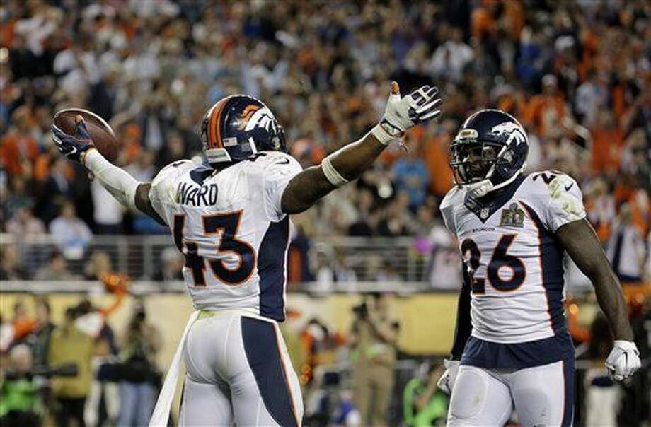 Denver Broncos' T.J. Ward (43) celebrates with Darian Stewart (26) after Ward recovers a fumble during the second half of the NFL Super Bowl 50 football game Sunday, Feb. 7, 2016, in Santa Clara, Calif. (AP Photo/Matt York)
