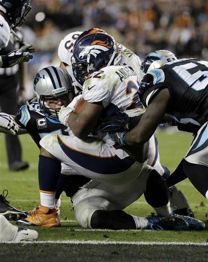 Denver Broncos' C.J. Anderson (22) scores a touchdown during the second half of the NFL Super Bowl 50 football game Sunday, Feb. 7, 2016, in Santa Clara, Calif. (AP Photo/Ben Margot)
