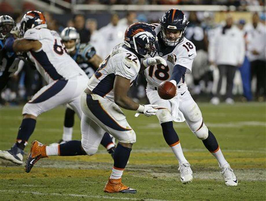 Denver Broncos' Peyton Manning (18) hands the ball off to C.J. Anderson (22) against the Carolina Panthers during the second half of the NFL Super Bowl 50 football game Sunday, Feb. 7, 2016, in Santa Clara, Calif. (AP Photo/Matt Slocum)
