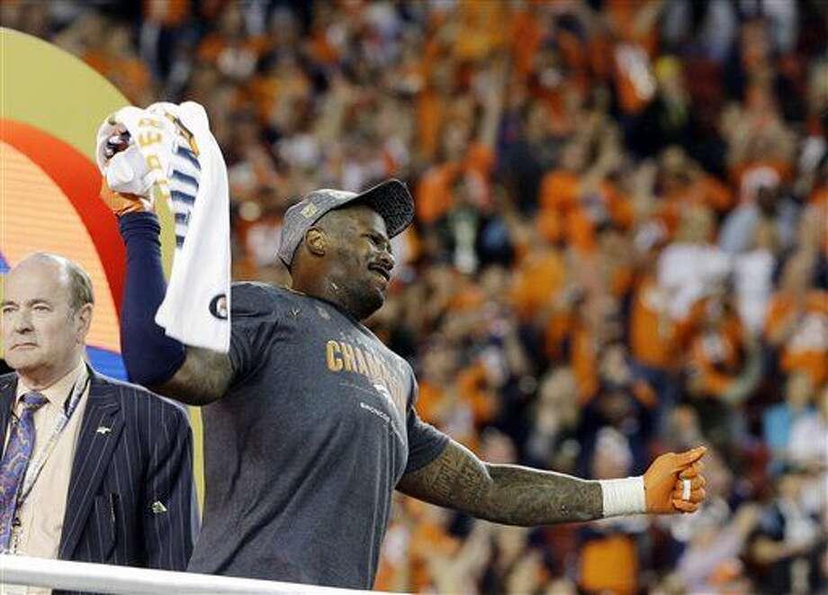 Denver Broncos' Von Miller (58) holds the trophy after the NFL Super Bowl 50 football game Sunday, Feb. 7, 2016, in Santa Clara, Calif. The Broncos won 24-10.(AP Photo/Julie Jacobson)