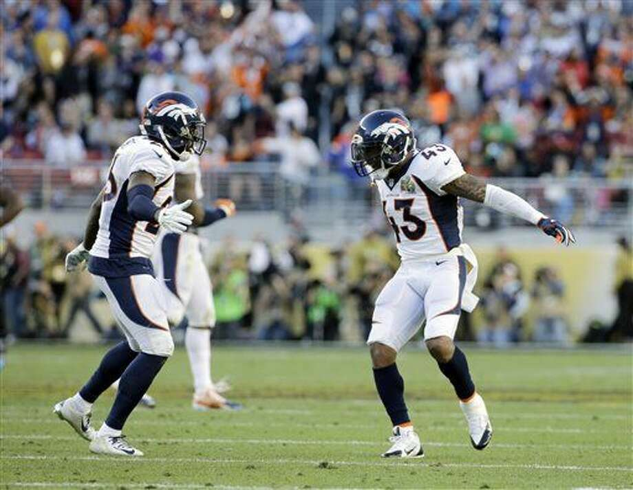 Denver Broncos' Darian Stewart (26) and T.J. Ward (43) celebrate after a play during the first half of the NFL Super Bowl 50 football game against the Carolina Panthers, Sunday, Feb. 7, 2016, in Santa Clara, Calif. (AP Photo/Jeff Chiu)