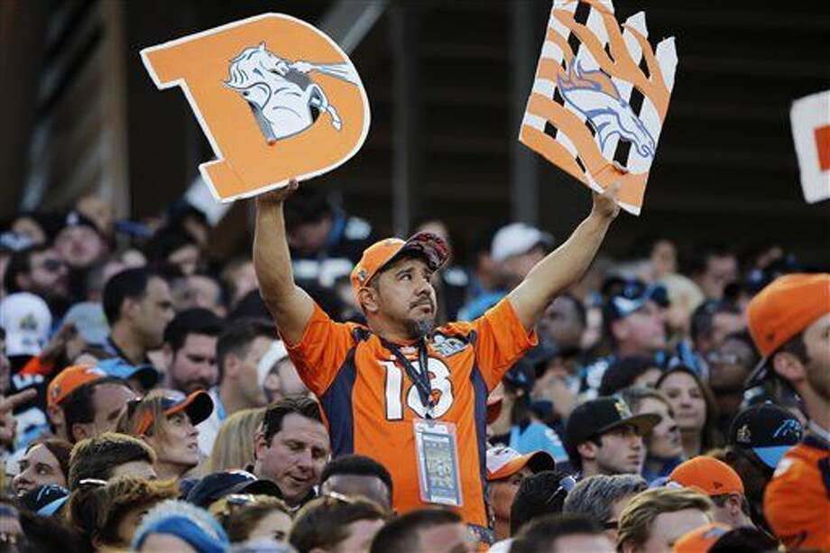 A Denver Broncos fan holds up signs during the first half of the NFL Super Bowl 50 football game against the Carolina Panthers, Sunday, Feb. 7, 2016, in Santa Clara, Calif. (AP Photo/Jae C. Hong)