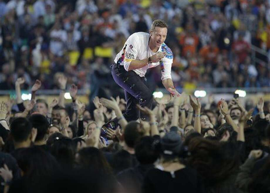 Coldplay singer Chris Martin performs during halftime of the NFL Super Bowl 50 football game Sunday, Feb. 7, 2016, in Santa Clara, Calif. (AP Photo/Gregory Bull)