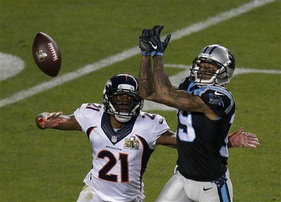Carolina Panthers' Ted Ginn Jr. (19) can't catch a pass with Denver Broncos' Aqib Talib (21) defending during the second half of the NFL Super Bowl 50 football game Sunday, Feb. 7, 2016, in Santa Clara, Calif. (AP Photo/Charlie Riedel)