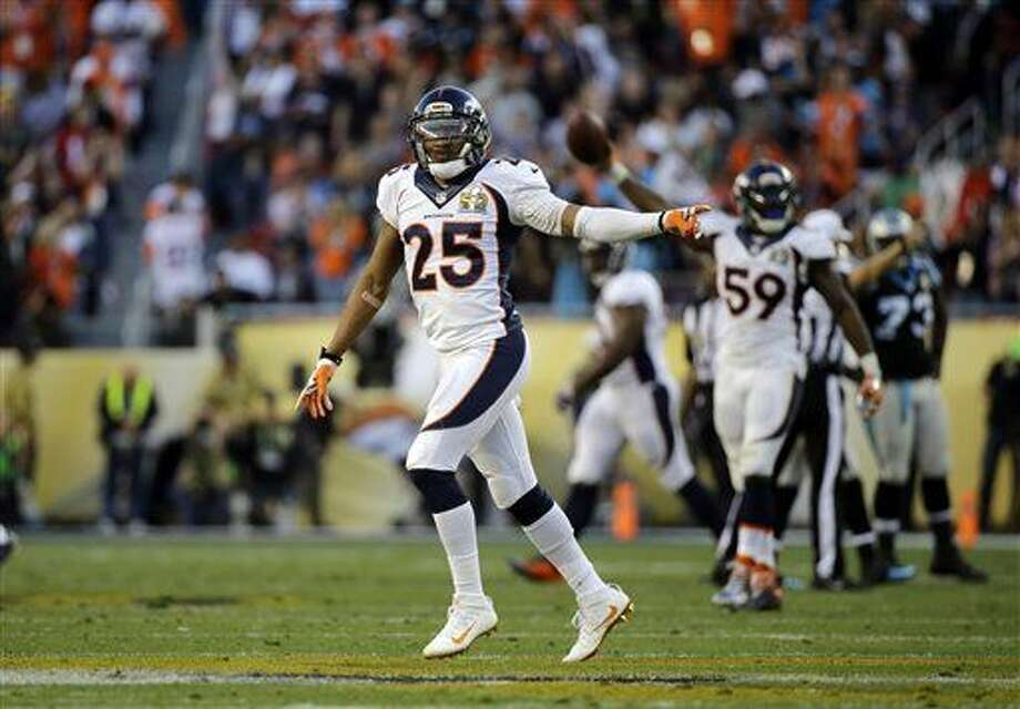 Denver Broncos' Chris Harris Jr. (25) celebrates a fumble recovery by Danny Trevathan (59) during the first half of the NFL Super Bowl 50 football game against the Carolina Panthers, Sunday, Feb. 7, 2016, in Santa Clara, Calif. (AP Photo/Ben Margot)