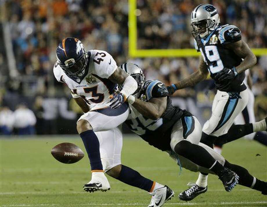 Carolina Panthers' Mike Tolbert (35) forces Denver Broncos' T.J. Ward (43) to fumble after he intercepted a pass by Panthers' quarterback Cam Newton during the second half of the NFL Super Bowl 50 football game Sunday, Feb. 7, 2016, in Santa Clara, Calif. Denver's Danny Trevathan recovered the fumble. (AP Photo/Ben Margot)