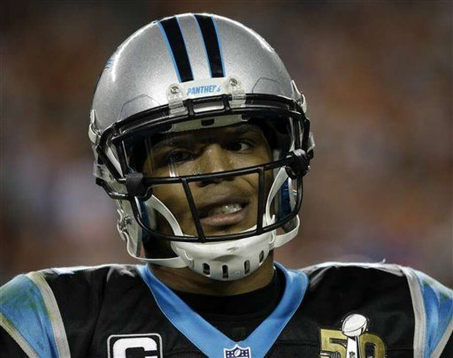 Carolina Panthers' Cam Newton (1) walks off the field after throwing an incomplete pass during the second half of the NFL Super Bowl 50 football game against the Denver Broncos Sunday, Feb. 7, 2016, in Santa Clara, Calif. (AP Photo/Gregory Bull)