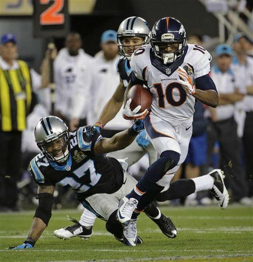 Denver Broncos' Emmanuel Sanders (10) runs by Carolina Panthers' Robert McClain, left, during the second half of the NFL Super Bowl 50 football game Sunday, Feb. 7, 2016, in Santa Clara, Calif. (AP Photo/Julio Cortez)