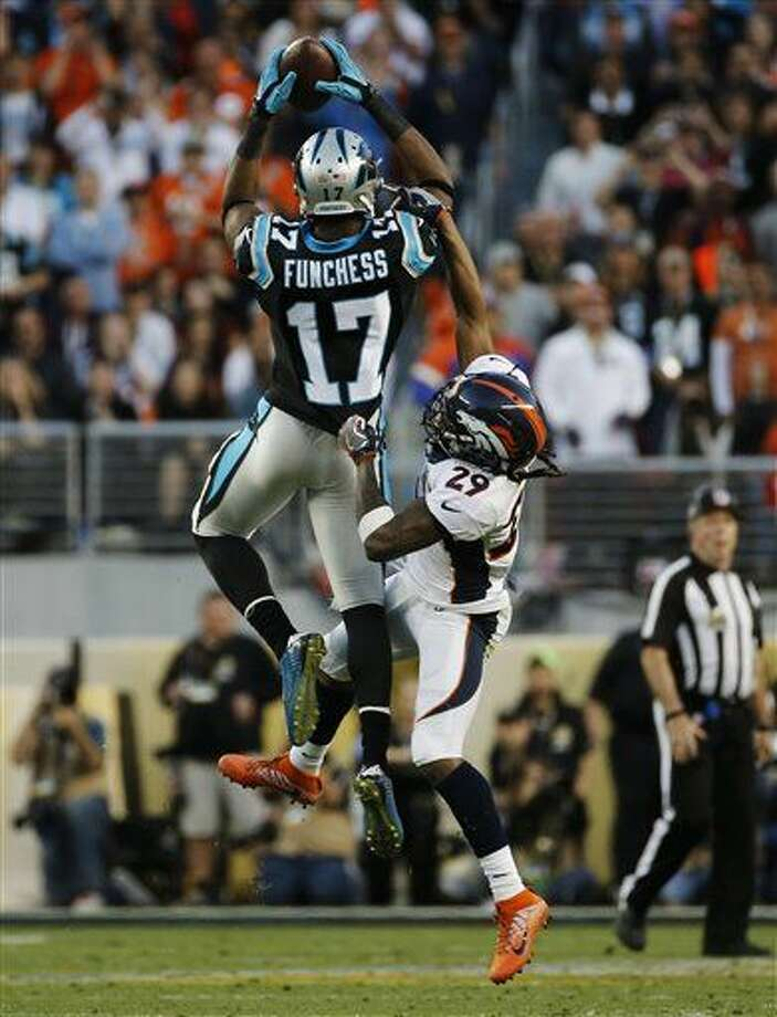 Carolina Panthers' Devin Funchess (17) pulls in a pass under pressure by Denver Broncos' Bradley Roby (29) during the first half of the NFL Super Bowl 50 football game Sunday, Feb. 7, 2016, in Santa Clara, Calif. (AP Photo/Matt Slocum)