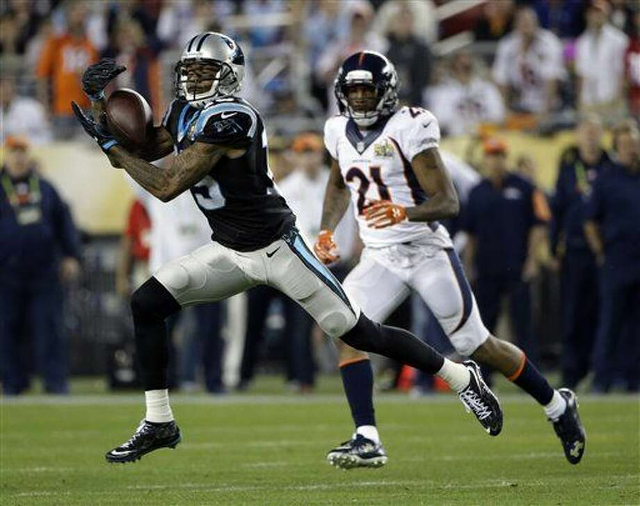 Carolina Panthers' Ted Ginn Jr. (19) catches a pass in front of Denver Broncos' Aqib Talib (21) during the second half of the NFL Super Bowl 50 football game Sunday, Feb. 7, 2016, in Santa Clara, Calif. (AP Photo/Marcio Jose Sanchez)