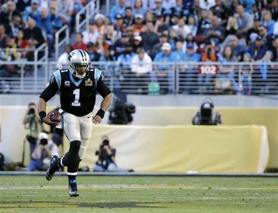 Carolina Panthers' Cam Newton (1) carries the ball during the first half of the NFL Super Bowl 50 football game Sunday, Feb. 7, 2016, in Santa Clara, Calif. (AP Photo/Jeff Chiu)