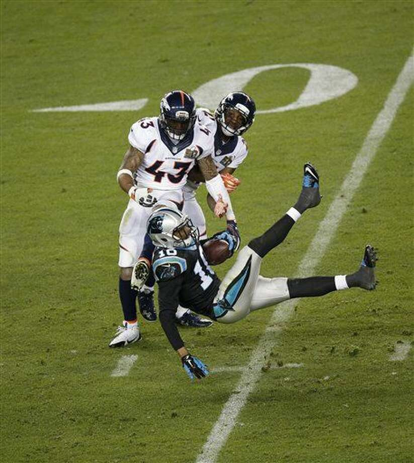 Carolina Panthers' Corey Brown (10) catches a ball against Denver Broncos' T.J. Ward (43) during the second half of the NFL Super Bowl 50 football game Sunday, Feb. 7, 2016, in Santa Clara, Calif. (AP Photo/Charlie Riedel)