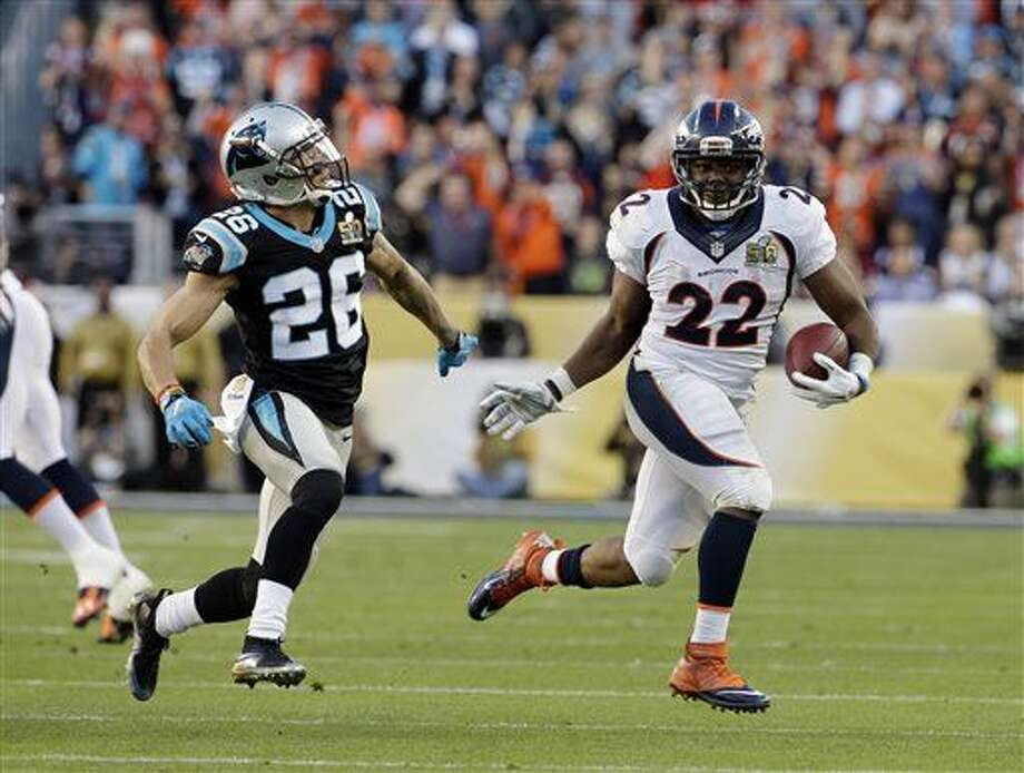 Denver Broncos' C.J. Anderson (22) breaks free for a run against Carolina Panthers' Cortland Finnegan (26) during the first half of the NFL Super Bowl 50 football game Sunday, Feb. 7, 2016, in Santa Clara, Calif. (AP Photo/Matt York)