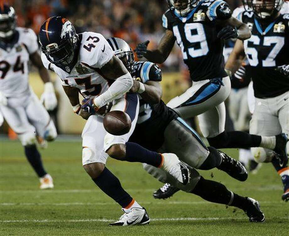 Carolina Panthers' Mike Tolbert, right, forces a fumble by Denver Broncos' T.J. Ward (43) during the second half of the NFL Super Bowl 50 football game Sunday, Feb. 7, 2016, in Santa Clara, Calif. (AP Photo/Matt Slocum)