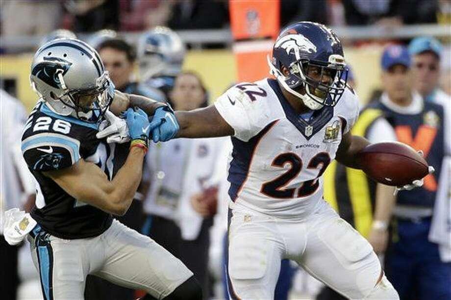Denver Broncos' C.J. Anderson, right, pushes off Carolina Panthers' Cortland Finnegan during the first half of the NFL Super Bowl 50 football game Sunday, Feb. 7, 2016, in Santa Clara, Calif. (AP Photo/Jae C. Hong)