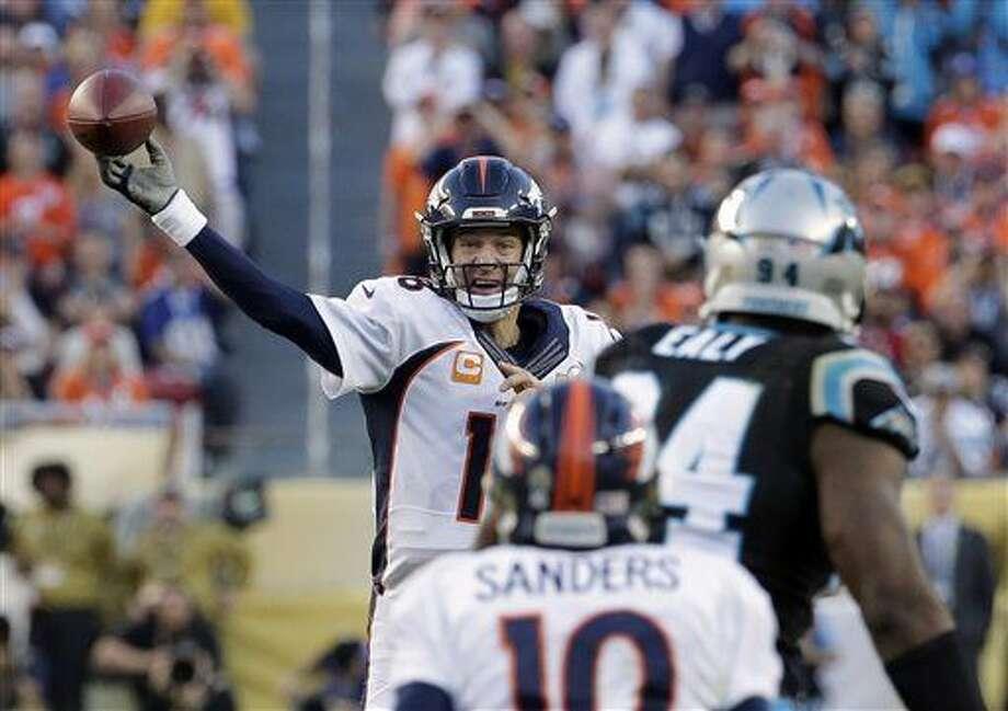 Denver Broncos' Peyton Manning (18) throws during the first half of the NFL Super Bowl 50 football game Sunday, Feb. 7, 2016, in Santa Clara, Calif. (AP Photo/Matt York)
