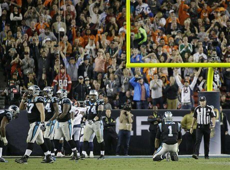 Carolina Panthers' Cam Newton (1) kneels on the field during the second half of the NFL Super Bowl 50 football game against the Denver Broncos, Sunday, Feb. 7, 2016, in Santa Clara, Calif. (AP Photo/Julie Jacobson)