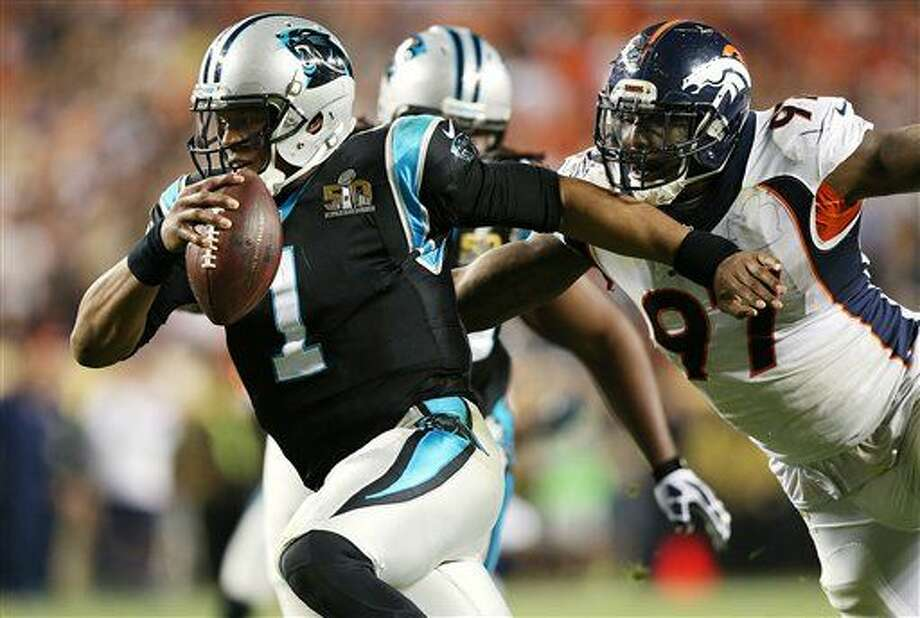 Denver Broncos defensive end Malik Jackson (97) chases Carolina Panthers quarterback Cam Newton (1) during Super Bowl 50, Sunday, Jan. 7, 2016 in Santa Clara, Calif. (AP Photo/Doug Benc)
