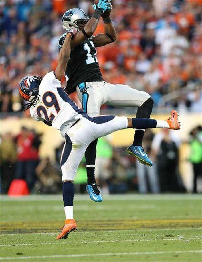 Carolina Panthers wide receiver Devin Funchess (17) catches a pass over Denver Broncos defensive back Bradley Roby (29) the Denver Broncos during Super Bowl 50, Sunday, Jan. 7, 2016 in Santa Clara, Calif. (AP Photo/Doug Benc)