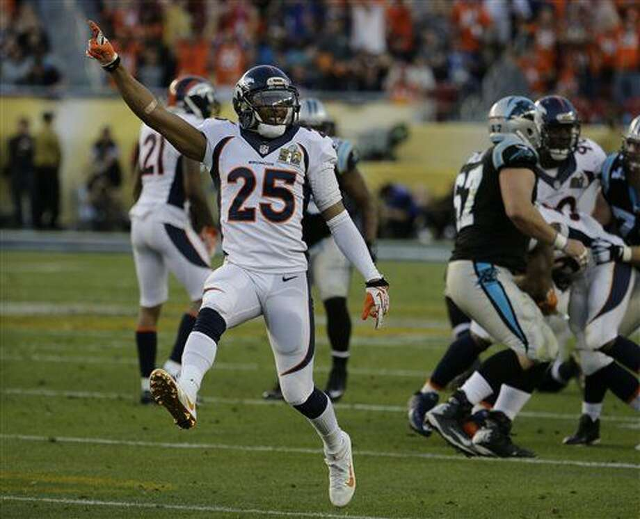 Denver Broncos' Chris Harris Jr. (25) reacts after the Broncos recovered a fumble by the Carolina Panthers during the first half of the NFL Super Bowl 50 football game Sunday, Feb. 7, 2016, in Santa Clara, Calif. (AP Photo/Gregory Bull)