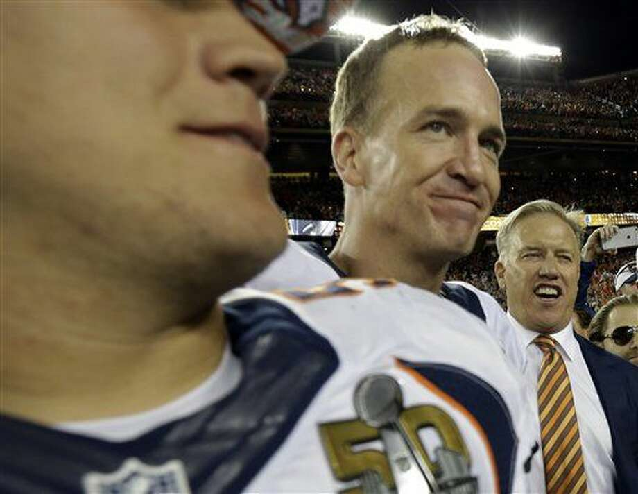 John Elway, General Manager and Executive Vice President of Football Operations for the Denver Broncos, right, celebrates with Denver Broncos' Peyton Manning after the NFL Super Bowl 50 football game against the Carolina Panthers Sunday, Feb. 7, 2016, in Santa Clara, Calif. The Broncos won 24-10.(AP Photo/David J. Phillip)
