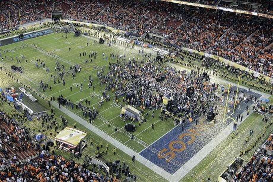 Players and people gather on the field after the NFL Super Bowl 50 football game between the Denver Broncos and the Carolina Panthers Sunday, Feb. 7, 2016, in Santa Clara, Calif. The Broncos won 24-10. (AP Photo/Morry Gash)