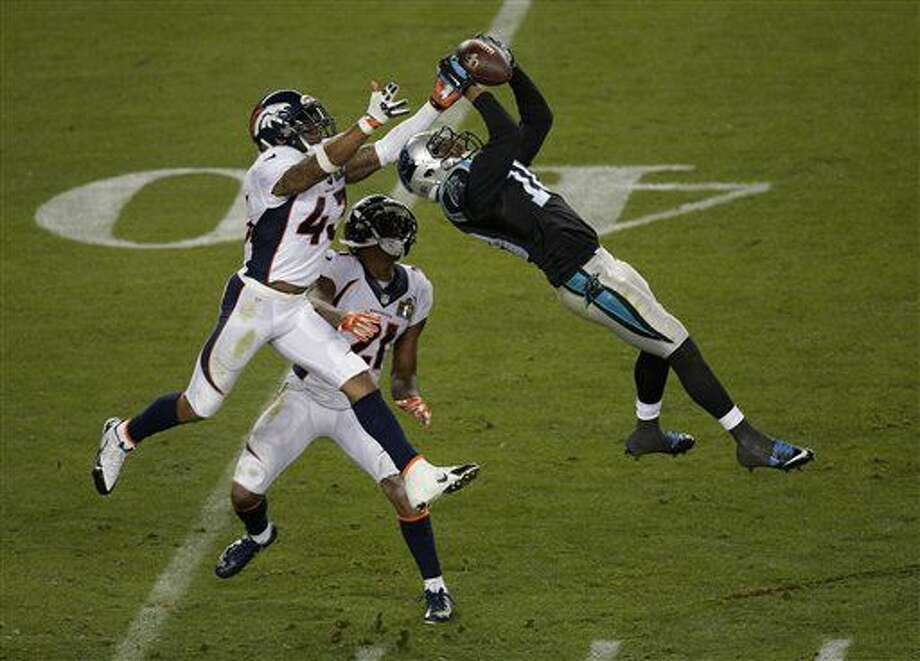 Carolina Panthers' Corey Brown (10) catches a pass in front of Denver Broncos' T.J. Ward (43) and Aqib Talib (21) during the second half of the NFL Super Bowl 50 football game Sunday, Feb. 7, 2016, in Santa Clara, Calif. (AP Photo/Charlie Riedel)
