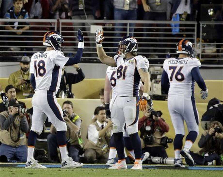 Denver Broncos' Peyton Manning (18) celebrates with Owen Daniels (81) during the second half of the NFL Super Bowl 50 football game against the Carolina Panthers, Sunday, Feb. 7, 2016, in Santa Clara, Calif. (AP Photo/Julie Jacobson)