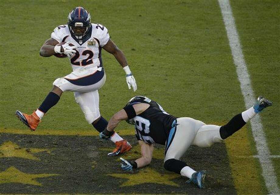 Denver Broncos' C.J. Anderson (22) runs past Carolina Panthers' Luke Kuechly (59) during the first half of the NFL Super Bowl 50 football game Sunday, Feb. 7, 2016, in Santa Clara, Calif. (AP Photo/Charlie Riedel)