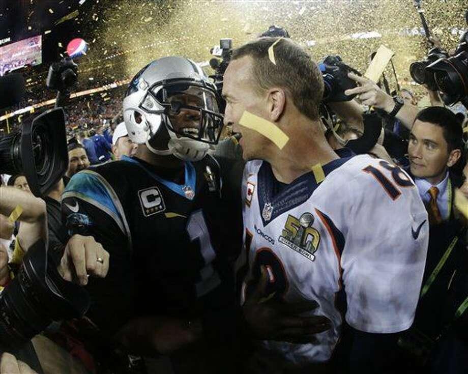 Denver Broncos' Peyton Manning, right, greets Carolina Panthers' Cam Newton (1) after the NFL Super Bowl 50 football game Sunday, Feb. 7, 2016, in Santa Clara, Calif. The Broncos won 24-10. (AP Photo/Julio Cortez)