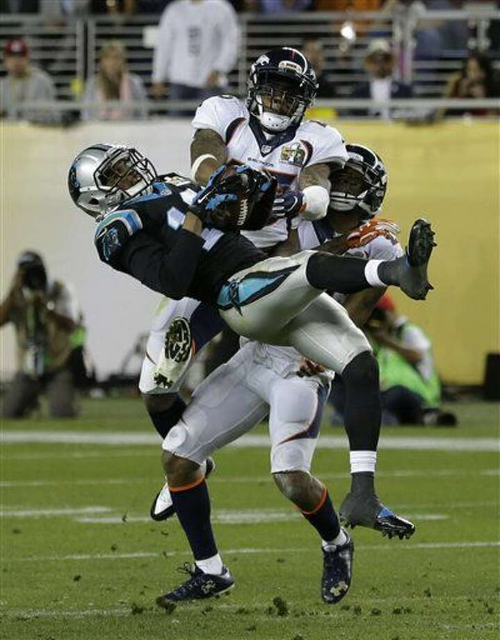 Carolina Panthers' Corey Brown (10) catches a pass in front of Denver Broncos' T.J. Ward (43) and Aqib Talib (21) during the second half of the NFL Super Bowl 50 football game Sunday, Feb. 7, 2016, in Santa Clara, Calif. (AP Photo/Gregory Bull)