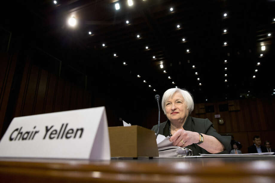 FILE - In this Thursday, Dec. 3, 2015, file photo, Federal Reserve Chair Janet Yellen prepares to testify on Capitol Hill in Washington, before the Joint Economic Committee. The Federal Reserve raised its key interest rate in mid-December from record lows and signaled the likelihood of four more hikes in 2016. Yet as Yellen addresses Congress on Wednesday, Feb. 10, 2016, turbulent markets, global weakness and slowdowns in key sectors are expected to lead the Fed to raise rates fewer than four times this year, if at all. (AP Photo/Jacquelyn Martin, File)
