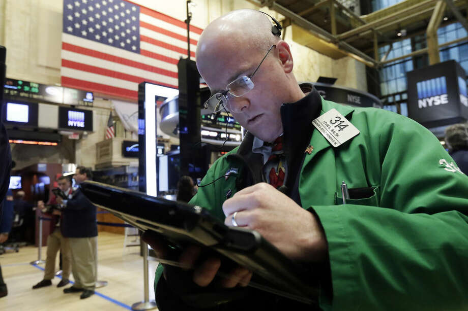 Trader Kevin Walsh works on the floor of the New York Stock Exchange, Monday, Feb. 8, 2016. U.S. stocks moved broadly lower in early trading Monday, putting the market on track for its second sizeable loss in a row. Technology, financial and energy stocks were among the biggest decliners. (AP Photo/Richard Drew)