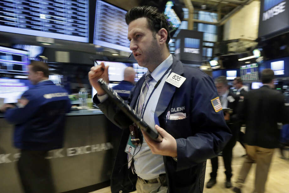 Trader Glenn Kessler hurries across the floor of the New York Stock Exchange, Monday, Feb. 8, 2016. U.S. stocks moved broadly lower in early trading Monday, putting the market on track for its second sizeable loss in a row. Technology, financial and energy stocks were among the biggest decliners. (AP Photo/Richard Drew)