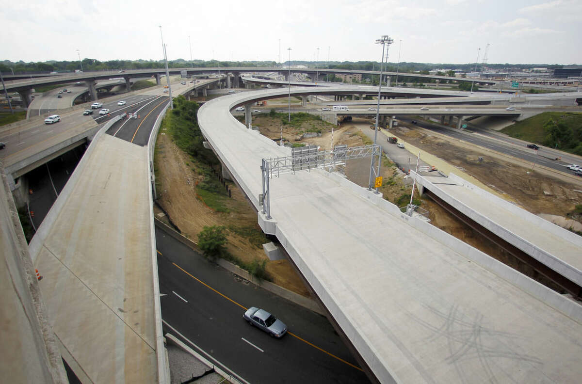 FILE - In this Wednesday, May 16, 2012 file photo, newly constructed roadways are being built in Fairfax County, Va. President Barack Obama's budget will propose an ambitious six-year, $478 billion public works program of highway, bridge and transit upgrades, half of it financed with a one-time mandatory tax on profits that U.S. companies have amassed overseas, White House officials said. Obama will unveil a $4 trillion budget on Monday, Feb. 2, 2015.(AP Photo/Haraz N. Ghanbari, File)