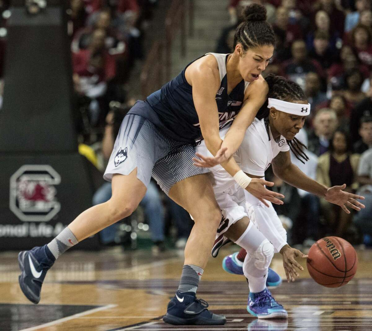 South Carolina guard Khadijah Sessions, right, battles Connecticut guard Kia Nurse for a loose ball during the first half of an NCAA college basketball game Monday, Feb. 8, 2016, in Columbia, S.C. (AP Photo/Sean Rayford)